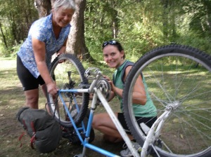 Our friend Wendy & I changing a tire along the Kettle Valley route