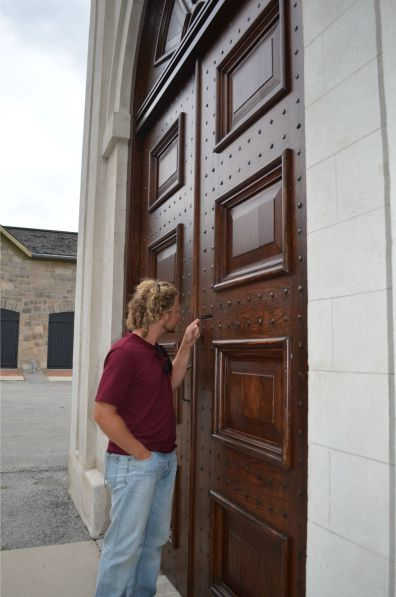 Alex inspecting the fine door