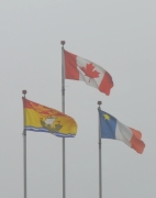 The three flags representing New Brunswick